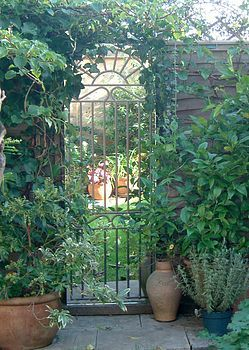 Looking glass gate - a garden gate with a mirror behind it, to give the illusion of a garden beyond it.