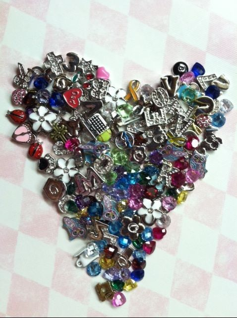 Can you guess how many charms make up this heart? One who guess it right wins a great charm of their choice at your Origami Owl Party!