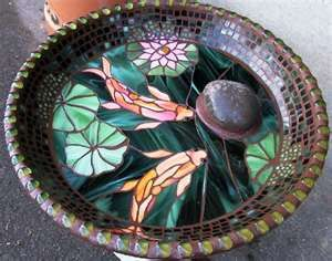 Mosaic Birdbaths.  This one is beautiful