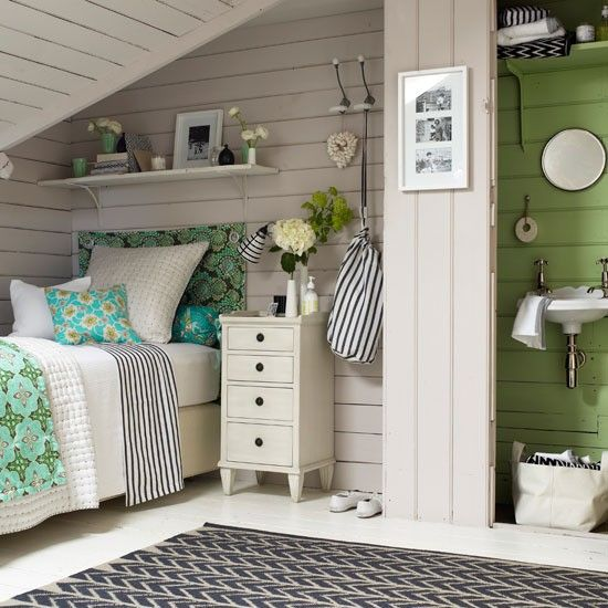 Cottage Chic Bedroom  bathroom in a attic style space.
