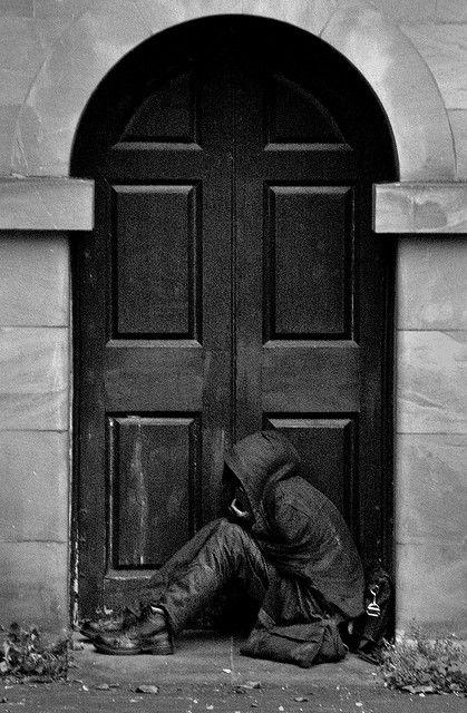 Unhappy soul in a doorway of St John's Church, Wolverhampton