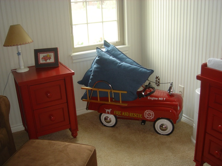I like how the pillows are in the pedal car.