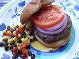 We make burgers 1/3 shredded veggies (I use zuccini, squash and onion) and 2/3 lean ground. The veggies keep it moist. Try it. They were a hit on the 4th! The veggies also add flavor...really yum.