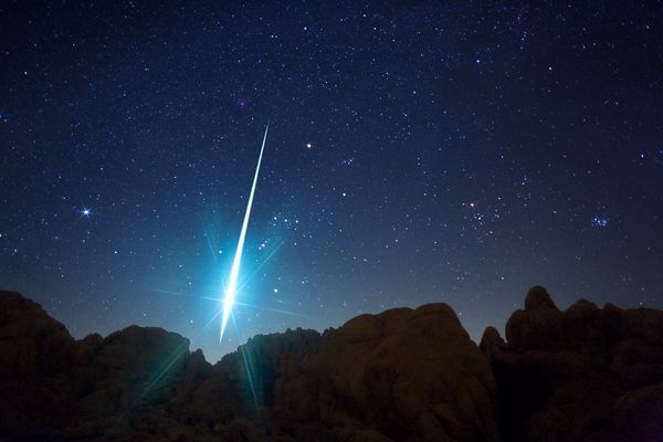 A bright Geminid meteor pierces the night sky over California's Mojave Desert in 2009.