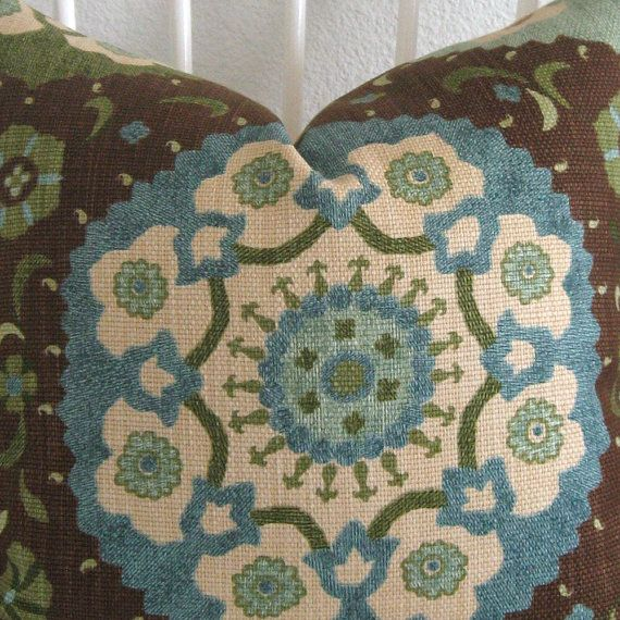 suzani blue, green, brown pillow. perfect to tie in our green bathroom with our blue/khaki bedroom