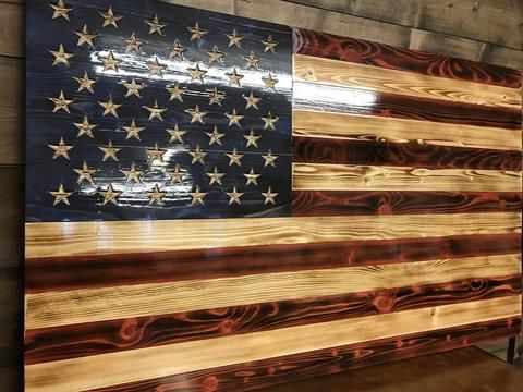 BEST SELLER! This flag has been built with American spruce and stained with Old Glory's...