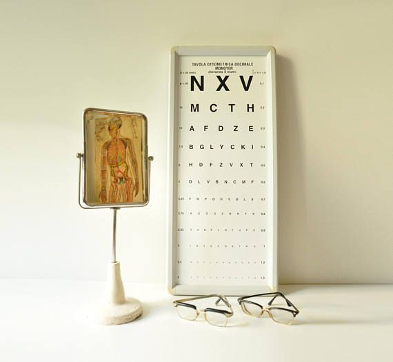 This unique, very rare, antique opticians mirror was manufactured by the italian optical company C.O.I. Compagnia Ottica Italiana in Milano.  It stands on a cast iron base, painted white and has on the back an optometry reading test in italian.  Dimensions: Mirror 15 cm X22 cm Base 12,5 cm diameter Total height 47 cm  - - - - - - - - - - - - - - - - - - - - - - - - - - - - - - - - - - - - - - - - - - - - - - - - - - - - - - - -  Please take a closer look at all photos for the best idea of…