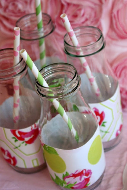 milk bottles (matching scrapbook paper strips wrapped around) with paper retro straws