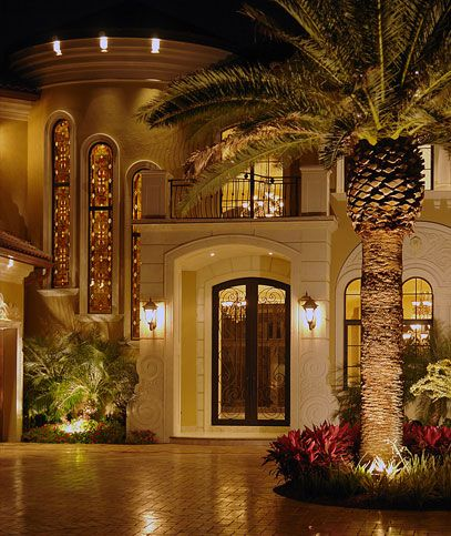 Woooooow so beautiful! Mediterranean style home with tropical landscaping and a magnificent entryway.