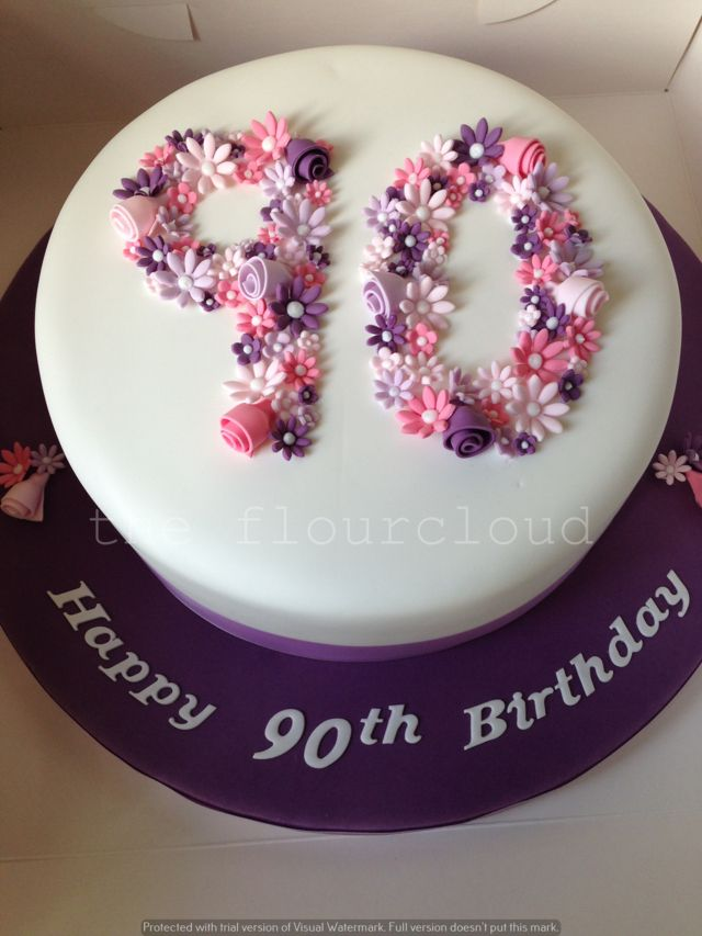 Delicate pink, purple and white flowers on this 90th birthday cake.