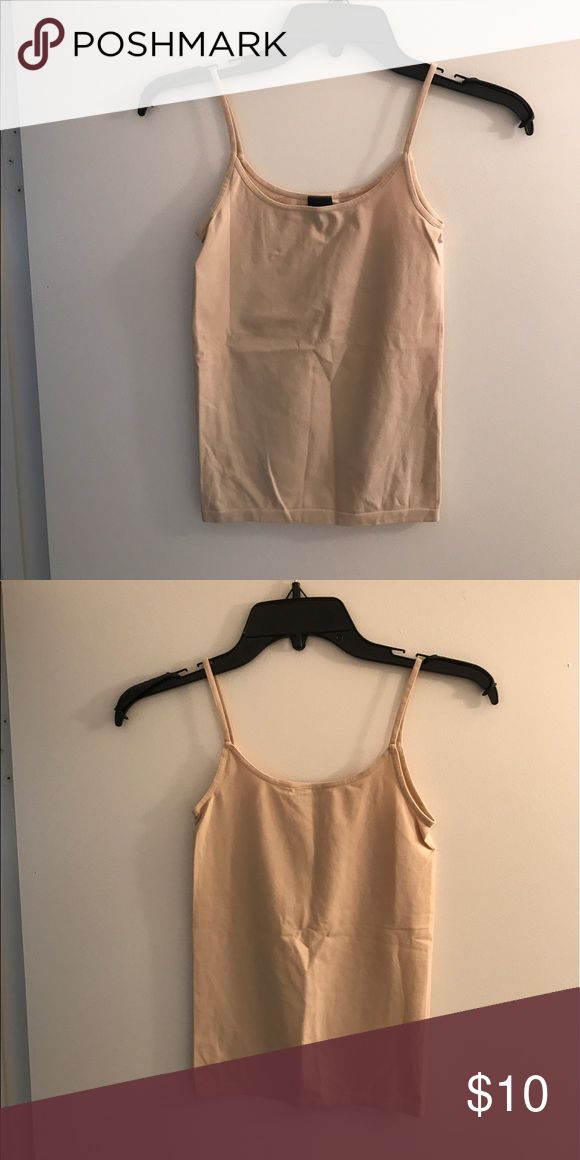 Nude cami from The Limited, EUC. Nude cami from The Limited. Spaghetti straps. Size x-small. Lightly used but in excellent condition. 92% nylon, 8% spandex. Smoke free home. The Limited Tops Camisoles