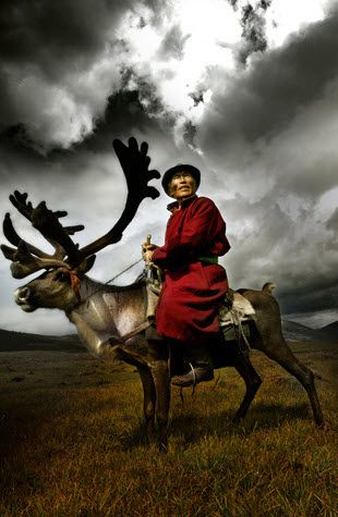 A tribal elder rides his reindeer across the steppes of Mongolia