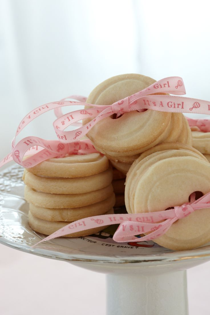 It's a Girl! Button Cookies. Tied together with fun and feminine pink ribbon, these are delights-to-go for baby shower guests.