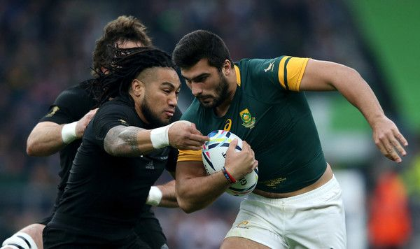 Ma'a Nonu Photos Photos - Damian De Allende of South Africa is tackled by Ma'a…