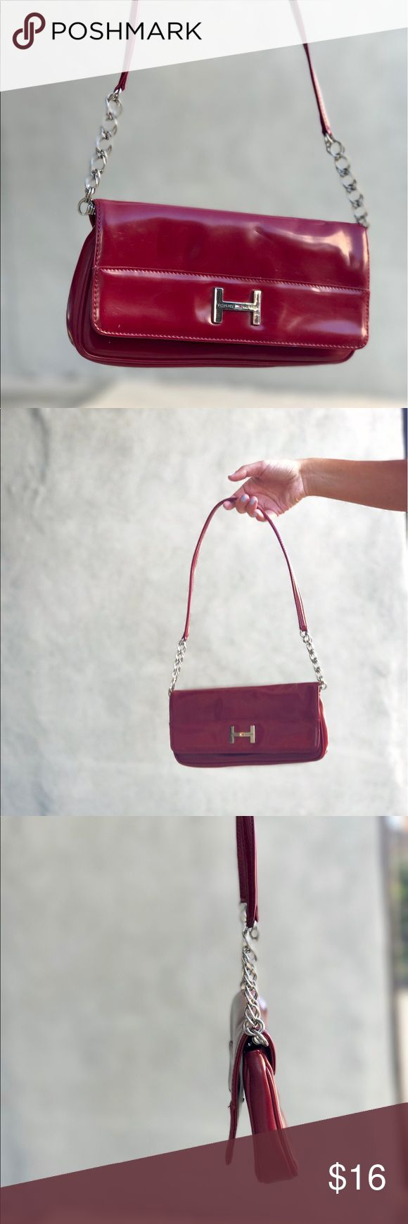 """Tommy Hilfiger Y2K Clutch/ mini bag I was trying to write a description while watching a movie, and realized the movie its harder than I thought and I am definitely not good at multitasking as I have been convinced for the past 27 years. Tommy Hilfiger red Mini Bag / purse / clutch / pochette. Clip on button, can be worn on the shoulder or as a maxi wallet in your hands. Minor scuffs and smudges. Also inside! 🙌🏼. Y2K. Measurements: 9.5"""" x 4.75"""". #tommy #hilfiger #tommyhilfiger #th #depop…"""