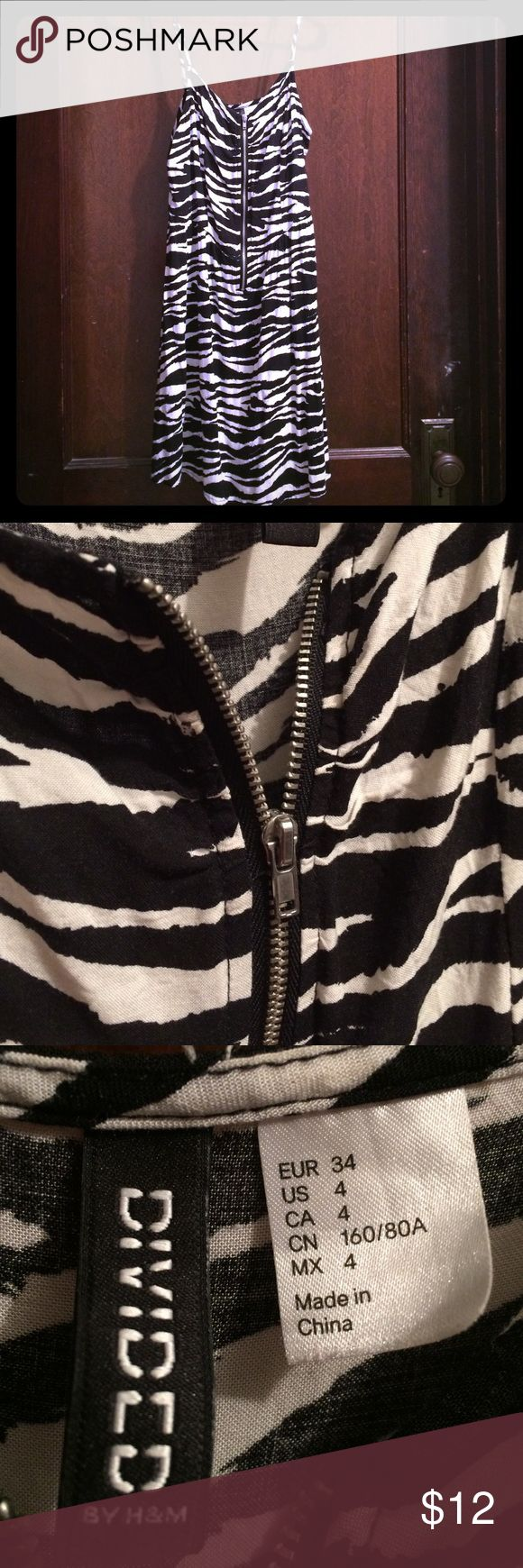 Cute zebra print dress from H&M Zebra print with zippered front. Fitted to waist then flares slightly from the hips. Adjustable straps. Comfortable, flattering shape. Brand is Divided from H&M. H&M Dresses