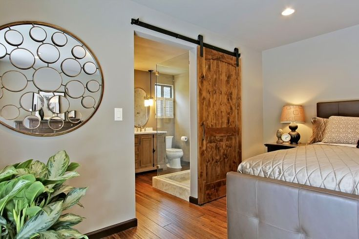 Interior. Bedroom Interior Idea Present Round Decorative Wall Mirror And Wood Sliding Home Barn Door. Interior Barn Doors For Homes
