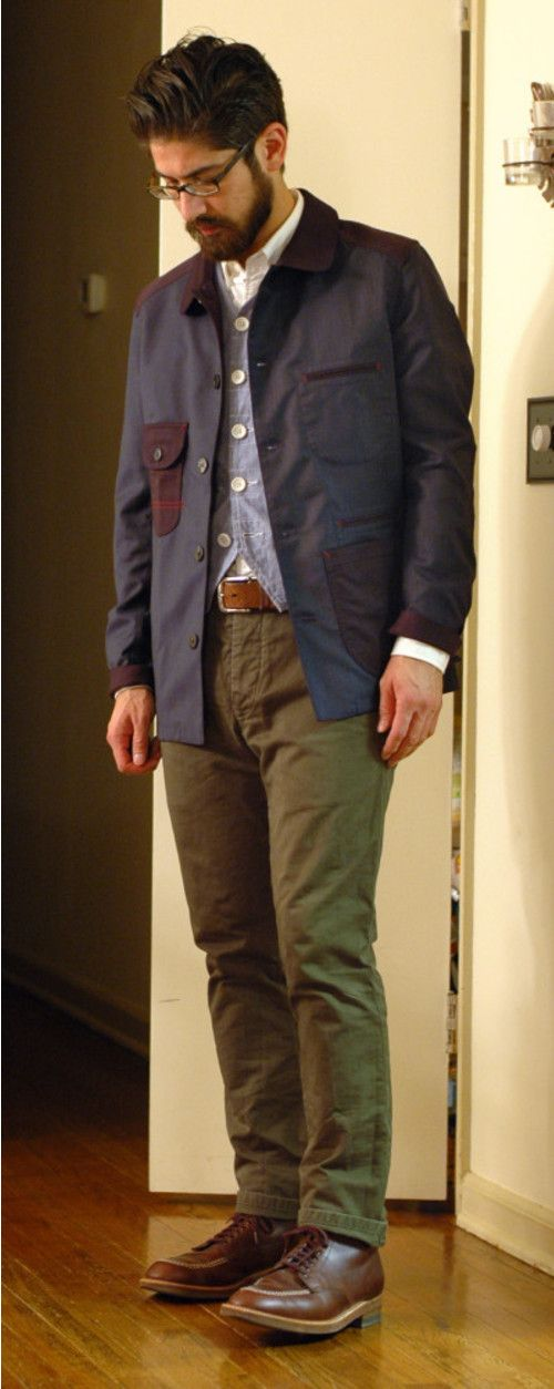 Shop this look on Lookastic:  http://lookastic.com/men/looks/boots-and-chinos-and-belt-and-barn-jacket-and-longsleeve-shirt-and-vest/70  — Brown Leather Boots  — Olive Chinos  — Brown Leather Belt  — Navy Barn Jacket  — White Long Sleeve Shirt  — Blue Waistcoat