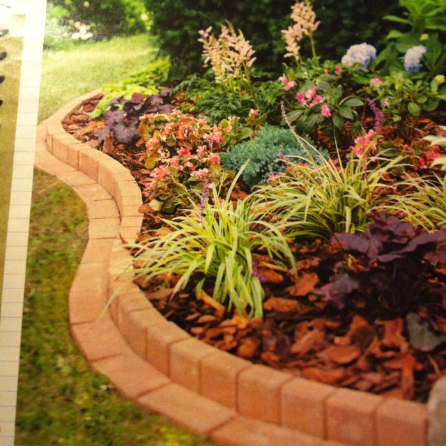 Edging - possibility for my rose garden -- best of both worlds -- flat for mowing but edge to keep mulch/dirt/gravel in.
