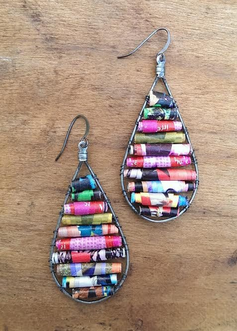 This is a pair of completely unique dangle earrings. Each bead is one-of-a-kind and hand crafted by myself using old magazines. After the beads set and are ready to use they are individually wire wrapped around hoop and secured safely. Approx size: 2.5 L x 1 W