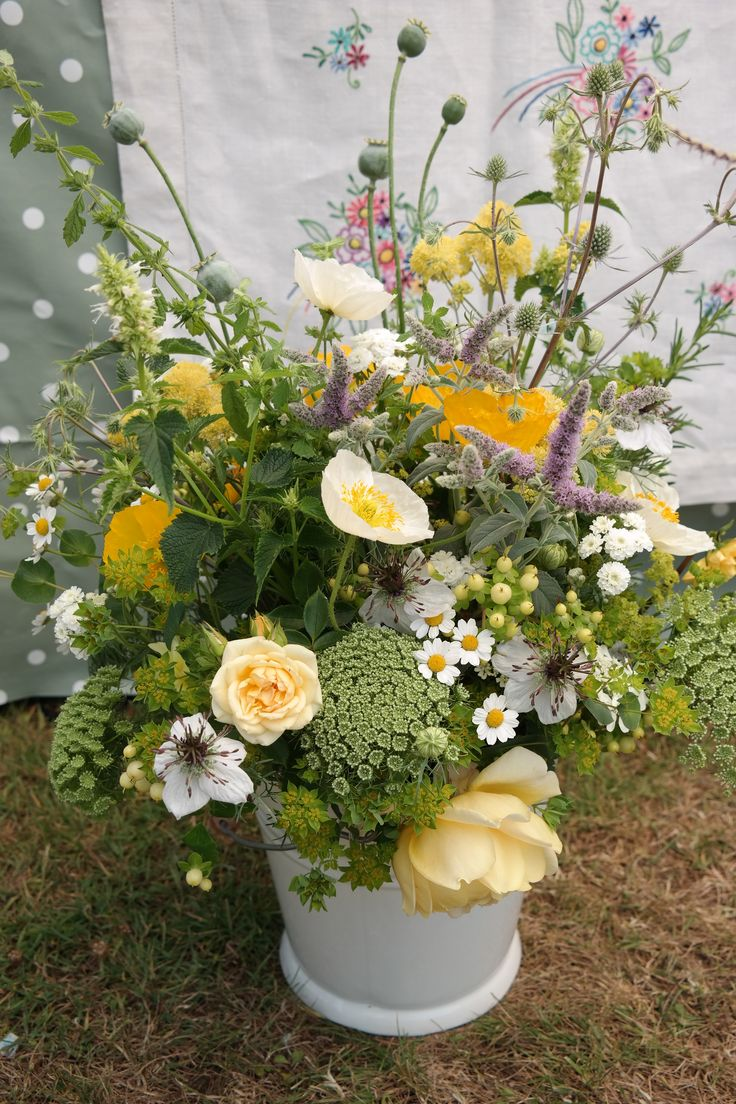 Yellow and white flowers in a bucket, British flowers in July.