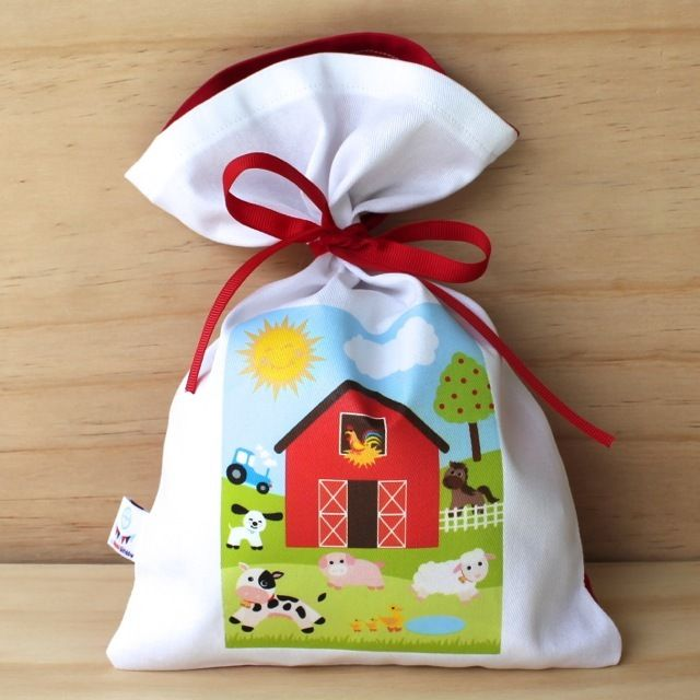 On that farm they had a � Celebration!Lovely cotton bag with a red ribbon tie.Size: 19.5cm x 28.5cmFabric: CottonSelect the 'Personalised' option to have a name placed on the bag.Or for no name, select 'Standard'