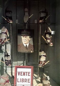 Vichy government head Marshal Pétain is the centrepiece of a shoe shop window display, pin by Paolo Marzioli