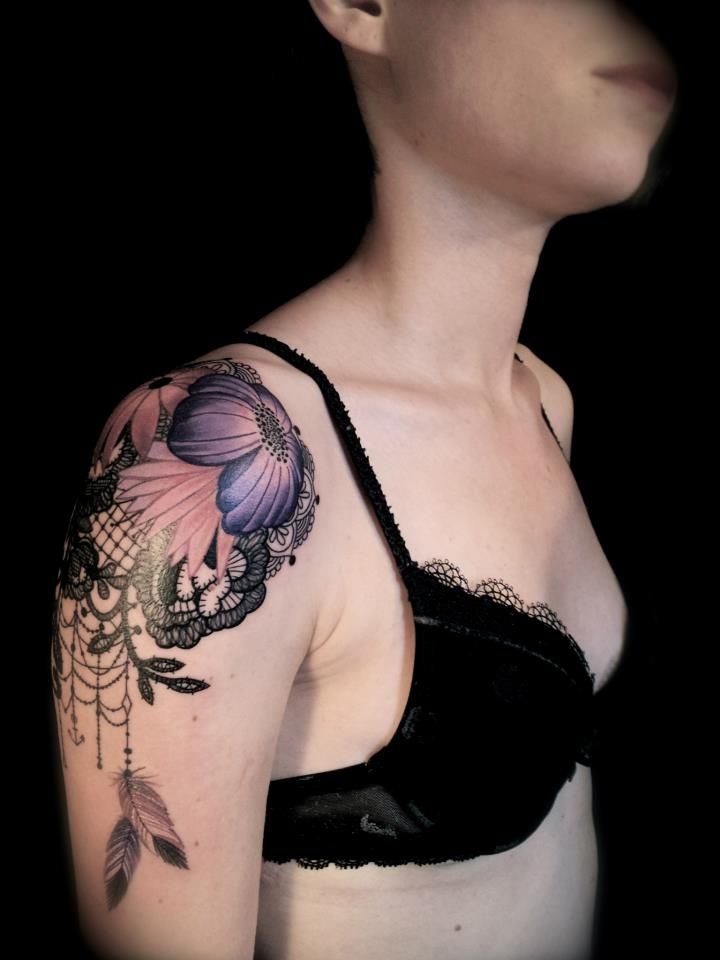 Front of the shoulder / lace tattoo... I would want the ...
