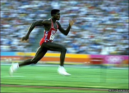American athlete Carl Lewis wins the first of his four Olympic long jump titles at the 1984 Los Angeles Games