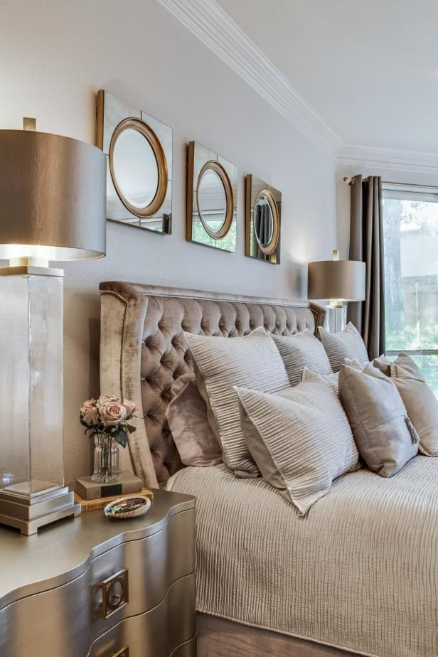 HGTV invites you to see this transitional master bedroom with a tufted velvet headboard and metallic accents.