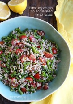 Lemon Asparagus Couscous Salad with Tomatoes - Whole wheat pearl couscous tossed with asparagus, tomatoes and lemon juice make a vibrant Spring pasta salad that is perfect for lunch, as a side dish, or even to make as a side dish if you are grilling! #weightwatchers #cleaneats #meatlessmondays #vegetarian #vegan