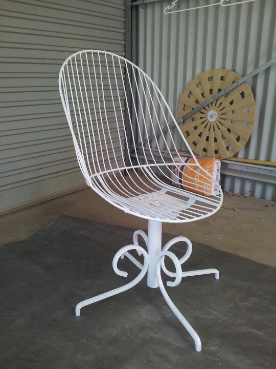 White swivel chair fixed up from dump