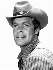 Doug McClure (1935–1995) was an American actor whose career in film & TV extended from the 1950s to the 1990s. He is best known for his role as the cowboy Trampas during the entire run from 1962 to 1971 of the NBC western TV series, The Virginian, loosely based on the Owen Wister novel. After the show ended, McClure starred in science fiction films such as At the Earth's Core, The Land That Time Forgot & The People That Time Forgot, all three based on the novels of Edgar Rice Burroughs.