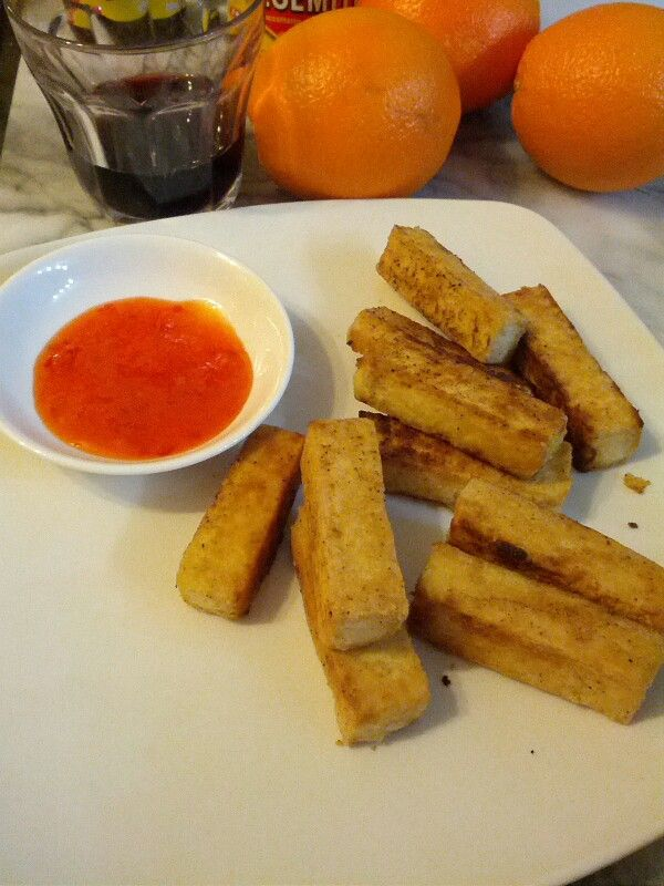 Tofu fingers: our favorite hot snack at the moment! Cut, dredge in seasoned flour and fry.