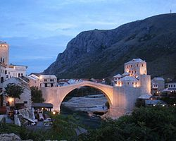 It  was so beautiful that it rose from the ashes of hatred to shine again...    Stari Most, Bosnia and Herzegovina.  Google Image Result for http://upload.wikimedia.org/wikipedia/commons/thumb/f/f8/Stari_Most_September_2004_4.jpg/250px-Stari_Most_September_2004_4.jpg