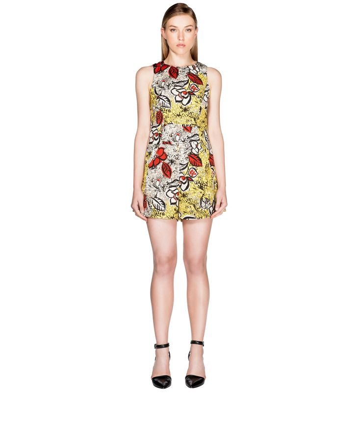 Floral Print Panelled Playsuit from Cue. Made from floral print satin fabric from Europe, this sleeveless playsuit features a racer neckline with tucks and bodice panelling. The slightly A-line shorts extend from the paneled waistband and feature back welt detail. Lined through the bodice, fastened with a metal zip back.