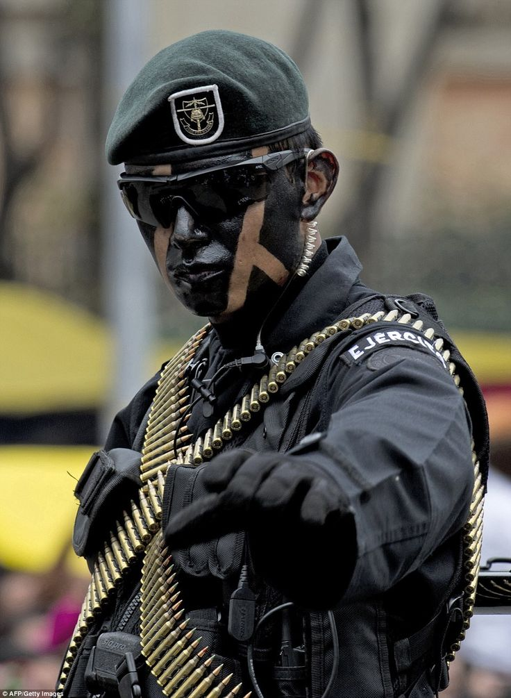 A soldier waves at the crowd during the military parade. some members of the military wore... Tags: #Fuerzas #Armadas #de #Mexico