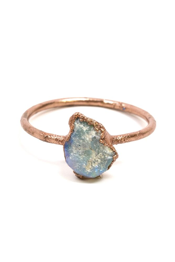 This sweet and small Raw Opal Ring from Moorea Seal is beautifully crafted by the Fox and Stone. Every piece is different and unique.