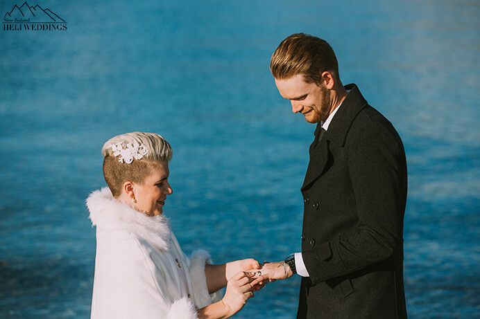 Queenstown 4wd wedding package with lakeside ceremony bride and groom exchange wedding rings
