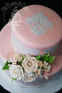 Understated elegance in this pink, ivory, and grey wedding cake. www.phdserts.com
