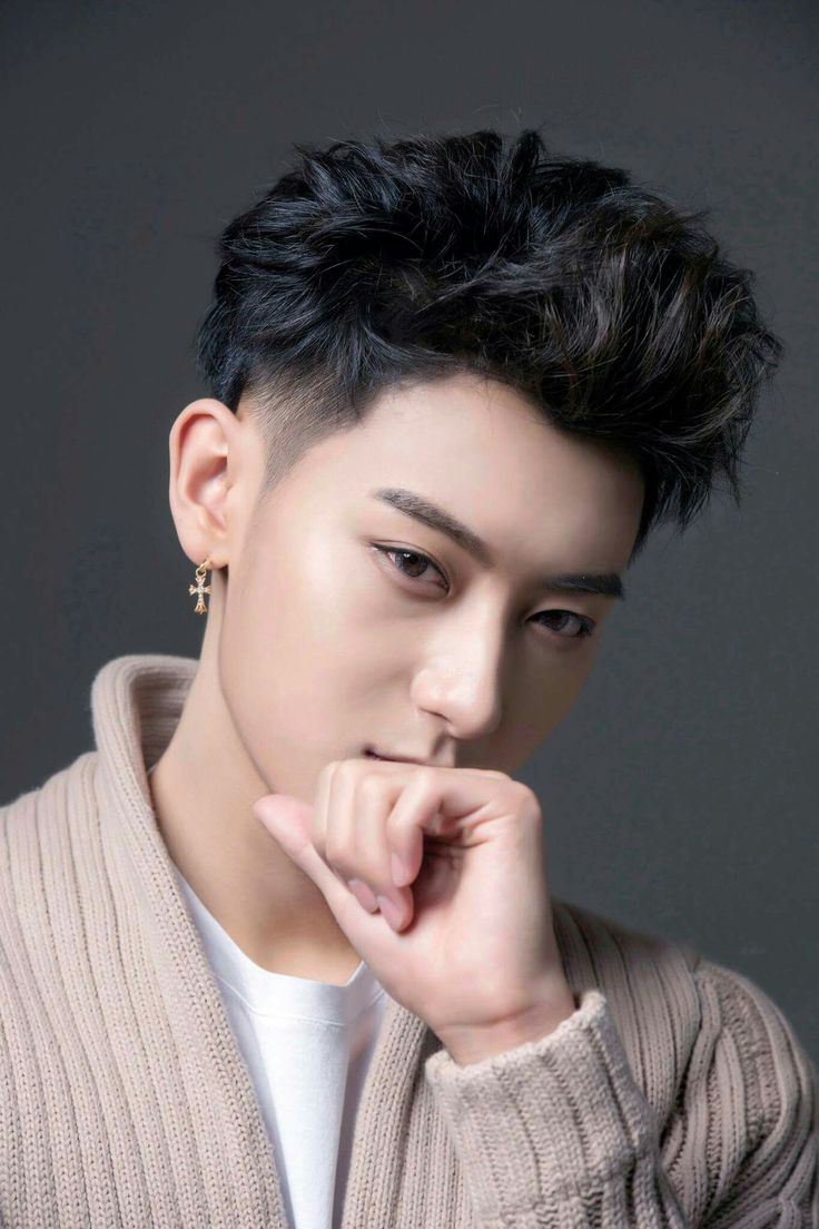 Huang Zitao also known as Z.TAO I'm in love with how attractive he looks with black hair! His smoldering stare tho.