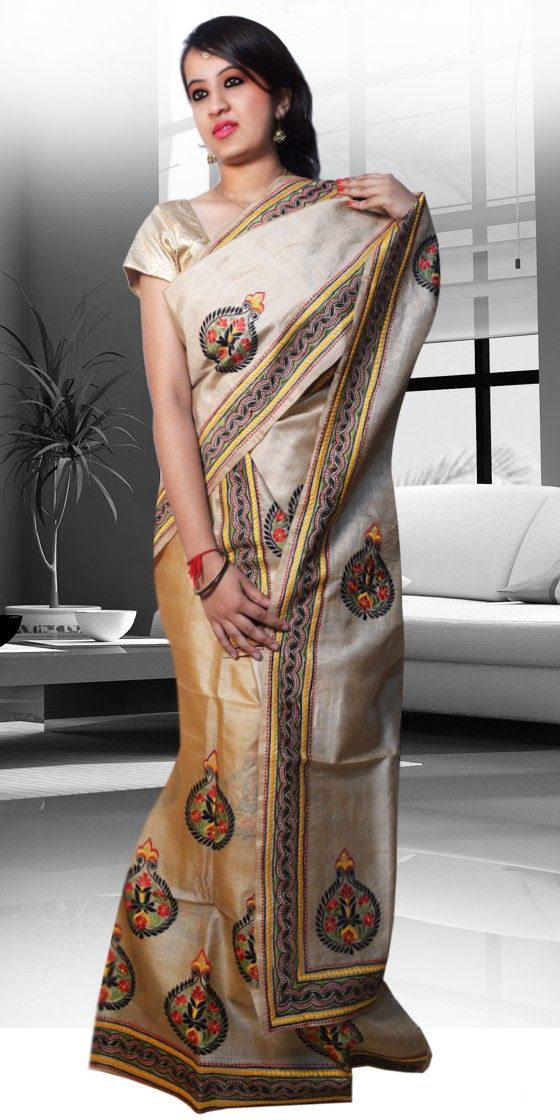 Beautiful Golden colour Assam Silk Tassar Mekhla Chadar with artistic hand work design on plain cloth  giving a Classic look to the two-piece. This unique design  is perfect for any Festive occasion. The Mekhla Chadar is a two pc. Saree which comes with matching blouse piece, the blouse shown in the image is just for display purpose.Slight colour variation may be there in display & acutal.