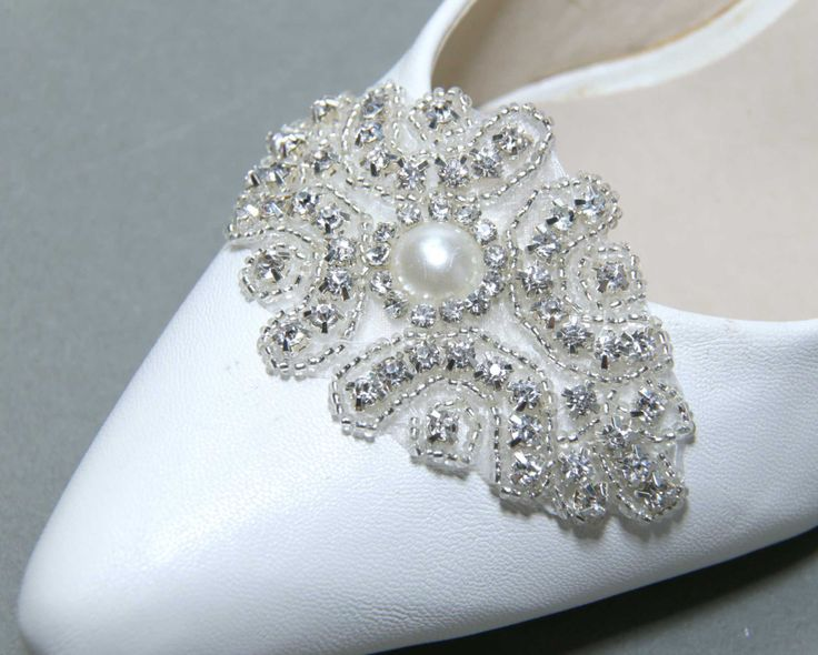 A Pair Of Bridal Shoe Clips,Wedding Shoe clips,Bridesmaids Shoes,Crystal Shoes Clips,Pearl Shoe Clips,Wedding Applique Shoe Clips by BlingGarden on Etsy https://www.etsy.com/listing/197621571/a-pair-of-bridal-shoe-clipswedding-shoe
