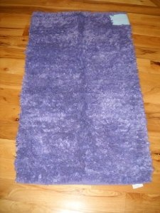 purple fuzzy rug