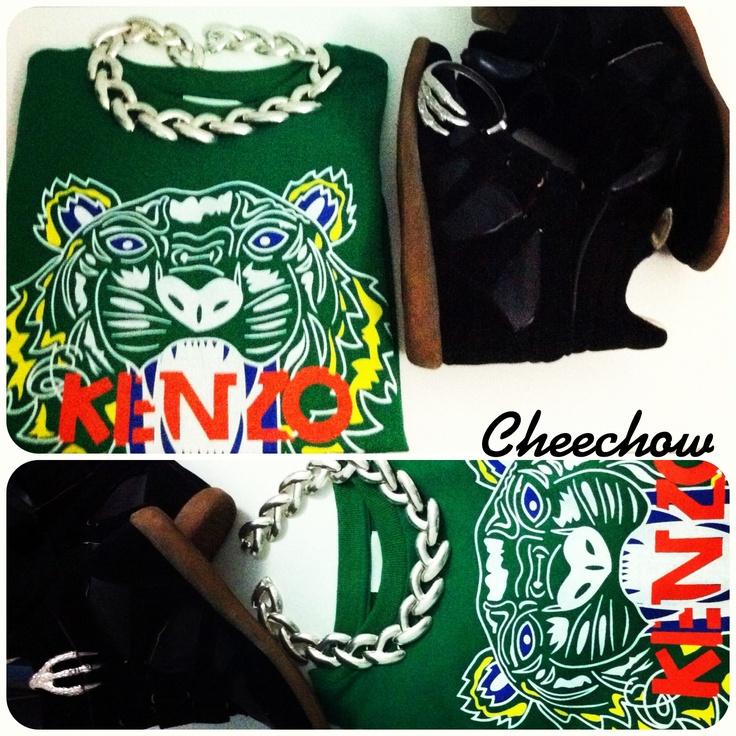 Statement necklace,kenzo sweatshirt,Isabel marant wedge sneakers,bracelet