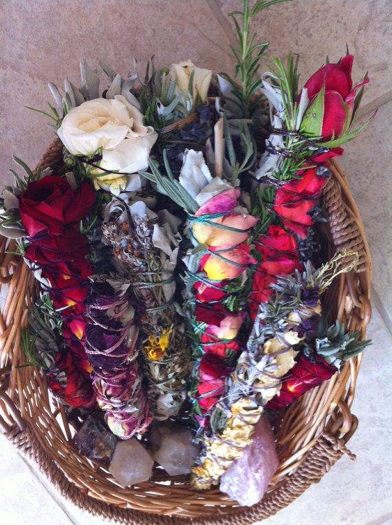 Altar your space and clear energy with these gorgeous smudge sticks adorned with roses and rosemary.