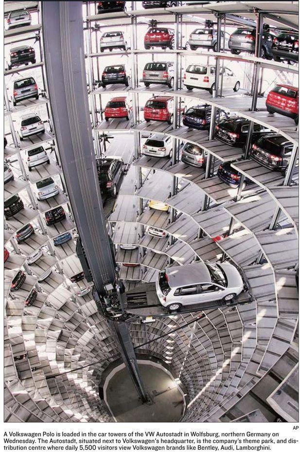 Volkswagen Polo being loaded into Volkswagen display garage