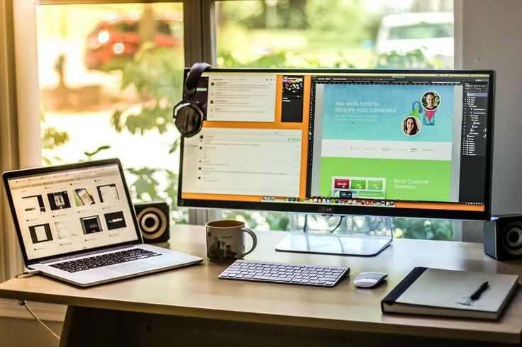 """Cameron Moll's desk with massive 34"""" screen."""