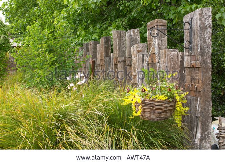 fence-made-from-old-railway-sleepers-with-grasses-AWT47A.jpg (1300×953)