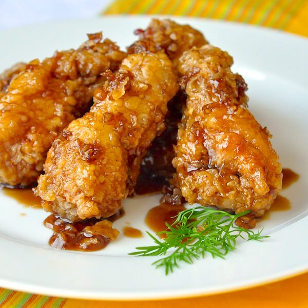 Crispy Honey Garlic Chicken Wings - Crispy fried wings tossed in an easy to make sticky honey garlic sauce just before serving, keeping them super crispy.